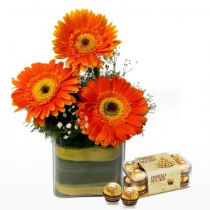 3 Orange Gerberas in Small Vase With Chocolates