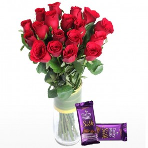15 Red Roses In Medium Vase Along With Chocolates