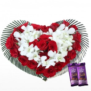 Heart Shape Arrangement - 25 Red Roses And 10 Orchids With Chocolates