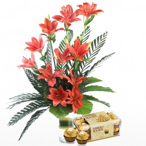 10 Red Lilies in Long Vase With Chocolates