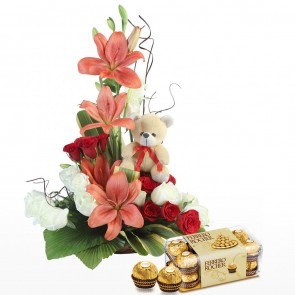 Teddy  With Red Roses Arrangement With Chocolates