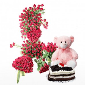 Full Room Of Red Roses With Cake And Teddy Bear